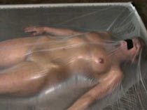 Slavegirl in the plastic vacuum bed